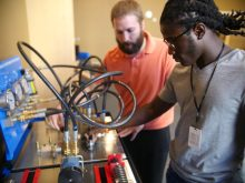 High school senior Lamarcus Fresh learns about hydraulic systems that are used in everything from cars and airplanes to construction machinery and barbershop chairs.