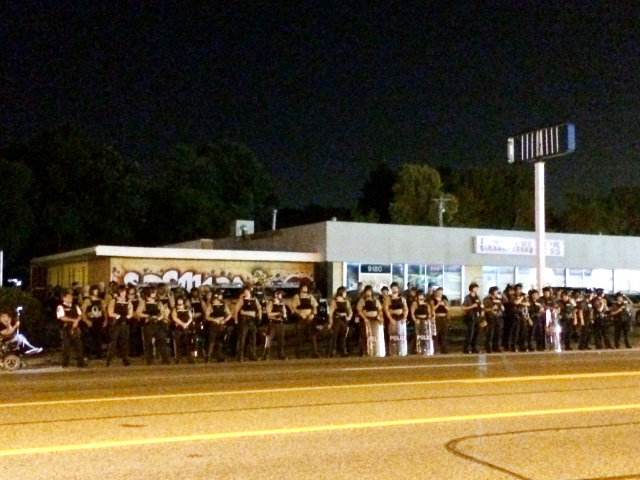 Ferguson police in riot gear at protest